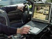 Laptop in Police Car